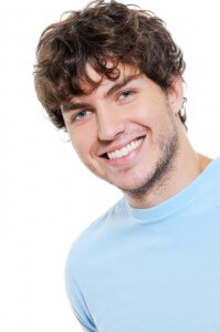 Portrait of happy cheerful handsome guy with brown curly hair